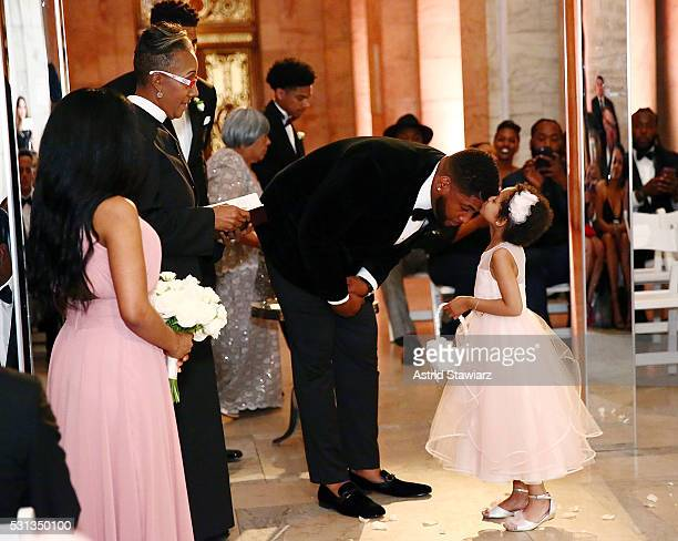 Player Devon Still greets his daughter Leah Still during The Knot Dream Wedding NFL Player Devon Still Marries Asha Joyce on May 13 2016 in New York...
