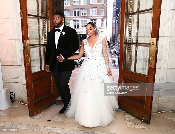 NFL Player Devon Still poses for photos with wife Asha Joyce after The Knot Dream Wedding NFL Player Devon Still Marries Asha Joyce on May 13 2016 in...