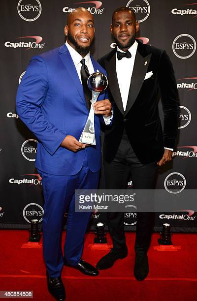 NFL player Devon Still with NBA player Lebron James with the Jimmy V Award for Perseverance at The 2015 ESPYS at Microsoft Theater on July 15 2015 in...