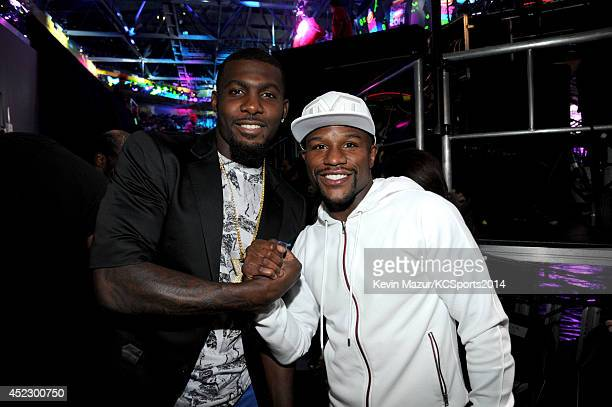 NFL player Dez Bryant and professional boxer Floyd Mayweather backstage during the Nickelodeon Kids' Choice Sports Awards 2014 at UCLA's Pauley...