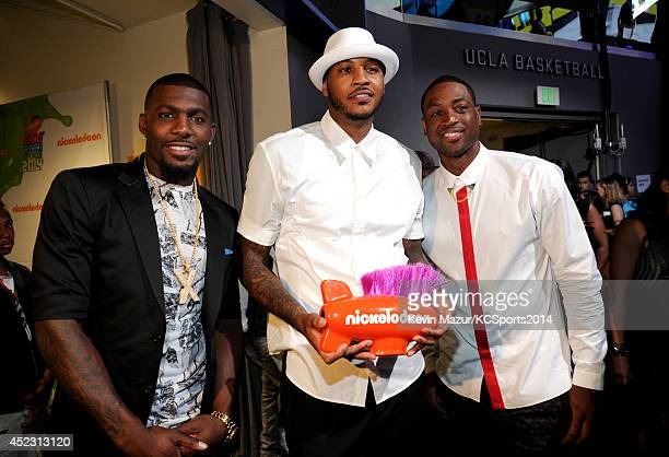 NFL player Dez Bryant NBA player Carmelo Anthony and NBA player Dwyane Wade attend the Nickelodeon Kids' Choice Sports Awards 2014 at UCLA's Pauley...