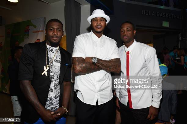NFL player Dez Bryant with NBA players Carmelo Anthony and Dwyane Wade backstage at the Nickelodeon Kids' Choice Sports Awards 2014 at UCLA's Pauley...