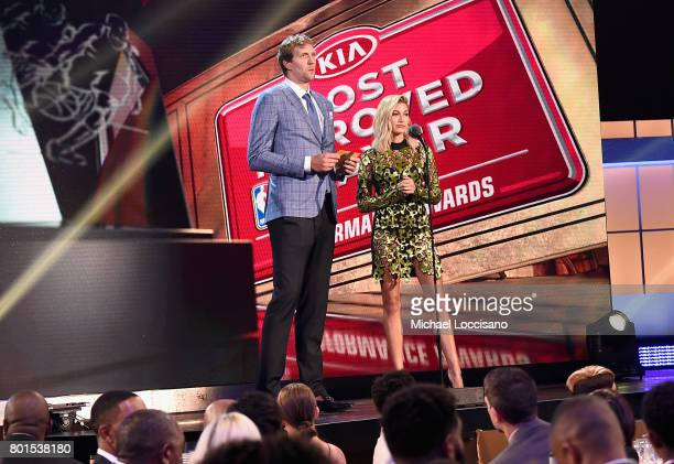 NBA player Dirk Nowitzki and Hailey Baldwin present the Most Improved Player Award on stage during the 2017 NBA Awards Live On TNT on June 26 2017 in...