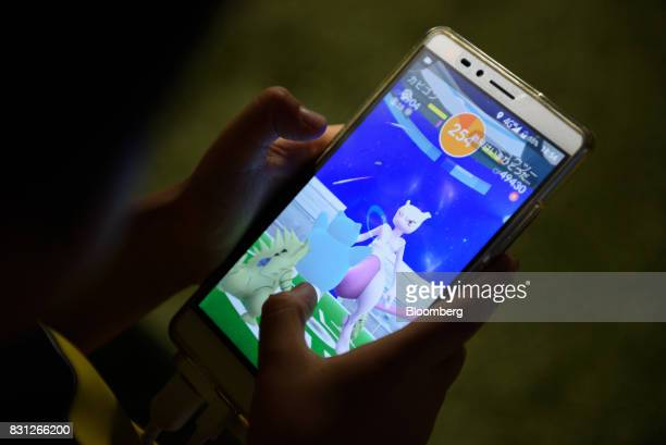 A player displays a Mewtwo character on their smartphone while playing Nintendo Co's Pokemon Go augmentedreality game developed by Niantic Inc during...