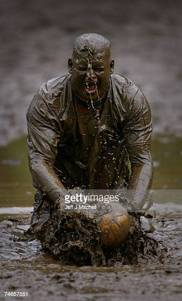 A player dives into mud whilst taking part in the annual UK Swamp Soccer tournament on June 16 2007 in Dunoon Scotland Swamp Soccer originates from...