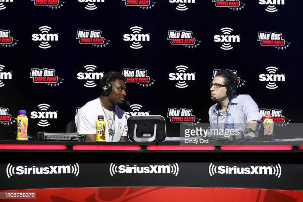 NFL player DK Metcalf of the Seattle Seahawks and SiriusXM host Adam Schein speak onstage during day 3 of SiriusXM at Super Bowl LIV on January 31...