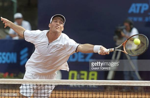 US player Donald Johnson reaches for the ball during the doubles' finals of the Mexican Tennis Open 27 February in Mexico City Byron Black and Donald...