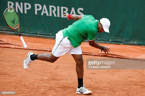 US player Donald Young looses his racket during his match against Russia's Teimuraz Gabashvili during their men's first round match at the Roland...