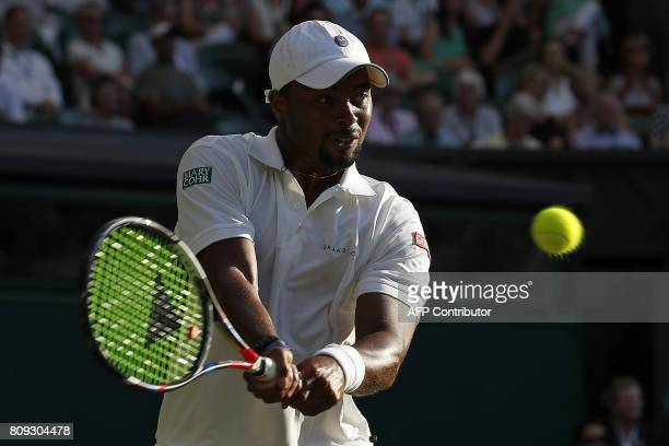 US player Donald Young returns against Spain's Rafael Nadal during their men's singles second round match on the third day of the 2017 Wimbledon...