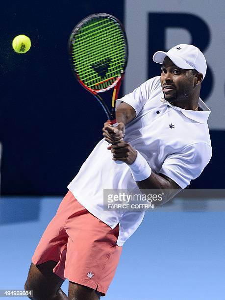 US player Donald Young returns the ball to his compatriot Jack Sock during their quarterfinal match at the Swiss Indoors tennis tournament on October...