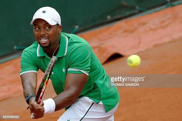 US player Donald Young returns the ball to Russia's Teimuraz Gabashvili during their men's first round match at the Roland Garros 2016 French Tennis...