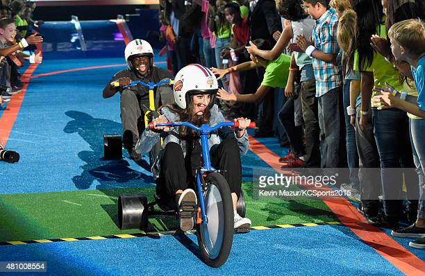 NBA player Draymond Green and USWNT soccer player Olympian Carli Lloyd play a game at the Nickelodeon Kids' Choice Sports Awards 2015 at UCLA's...