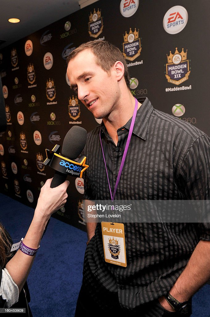 NFL player Drew Brees of the New Orleans Saints arrives at EA SPORTS Madden Bowl XIX at the Bud Light Hotel on January 31, 2013 in New Orleans, Louisiana.