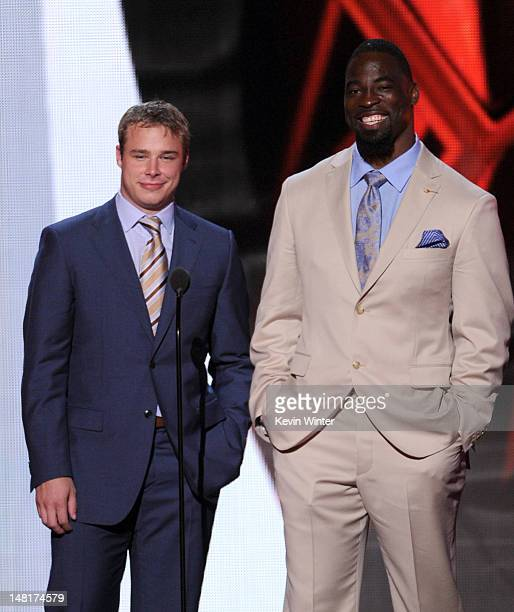 NHL player Dustin Brown and New York Giants football player Justin Tuck speak onstage during the 2012 ESPY Awards at Nokia Theatre LA Live on July 11...