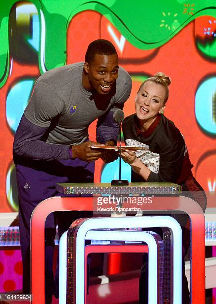 NBA player Dwight Howard and actress Kaley Cuoco speak onstage during Nickelodeon's 26th Annual Kids' Choice Awards at USC Galen Center on March 23...