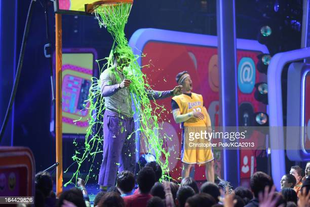 NBA player Dwight Howard and host Josh Duhamel onstage during Nickelodeon's 26th Annual Kids' Choice Awards at USC Galen Center on March 23 2013 in...