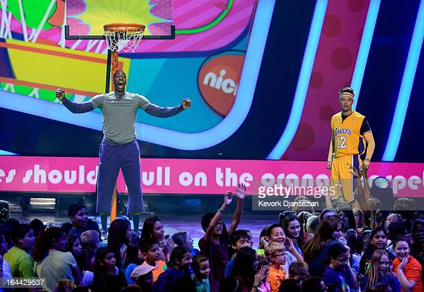 NBA player Dwight Howard and host Josh Duhamel speak onstage during Nickelodeon's 26th Annual Kids' Choice Awards at USC Galen Center on March 23...