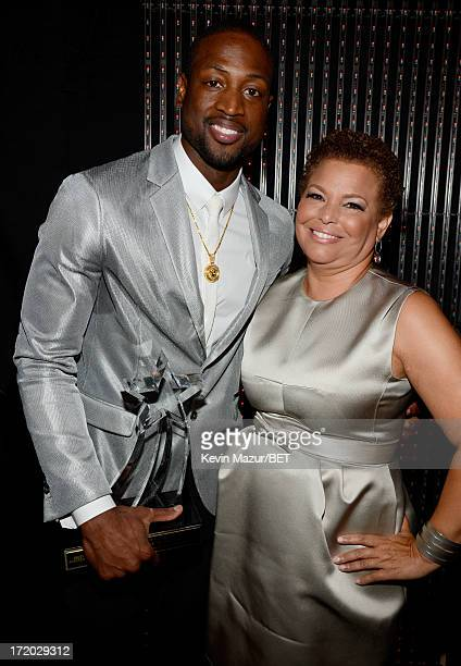 NBA player Dwyane Wade and Chairman and CEO of BET Networks Debra Lee pose backstage during the 2013 BET Awards at Nokia Theatre LA Live on June 30...