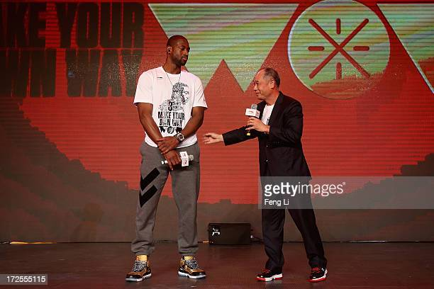 Player Dwyane Wade and Chinese gymnast and entrepreneur Li Ning attend a promotion event of Chinese sports brand Li Ning on July 3 2013 in Beijing...