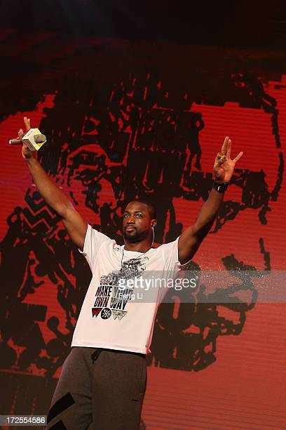 Player Dwyane Wade waves to his fans during a promotion event of Chinese sports brand Li Ning on July 3 2013 in Beijing China