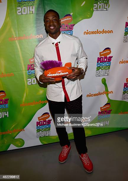 NBA player Dwyane Wade with award for Best Male Ahtlete at the Nickelodeon Kids' Choice Sports Awards 2014 at UCLA's Pauley Pavilion on July 17 2014...