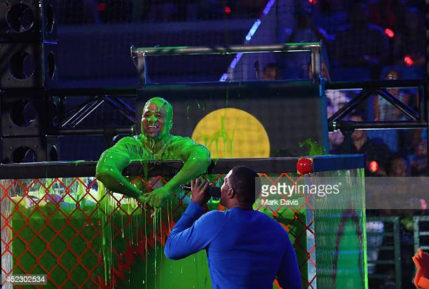 NFL player Earl Thomas and host Michael Strahan speak onstage during Nickelodeon Kids' Choice Sports Awards 2014 at UCLA's Pauley Pavilion on July 17...