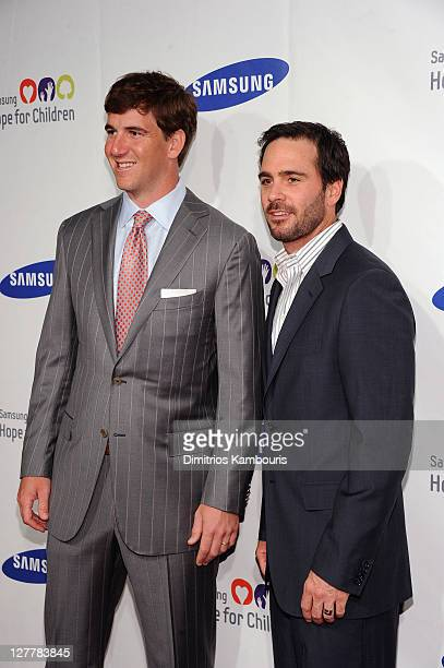 NFL player Eli Manning and NASCAR driver Jimmie Johnson attend Samsung Hope for Children Gala at Cipriani Wall Street on June 7 2011 in New York City