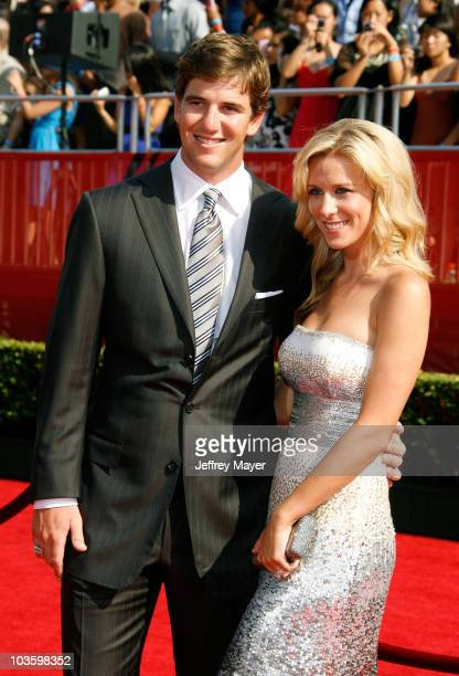 NFL player Eli Manning and wife Abby McGrew arrive at the 2008 ESPY Awards held at NOKIA Theatre LA LIVE on July 16 2008 in Los Angeles California...