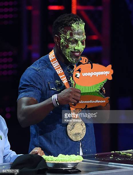 NFL player Emmanuel Sanders reacts after winning a pieeating contest onstage during the Nickelodeon Kids' Choice Sports Awards 2016 at UCLA's Pauley...