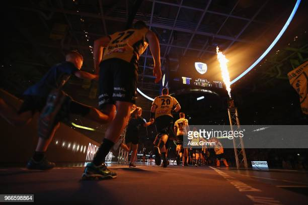 Player enter the court prior to the DKB HBL match between Rhein-Neckar Loewen and DHfK Leipzig at SAP Arena on June 3, 2018 in Mannheim, Germany.