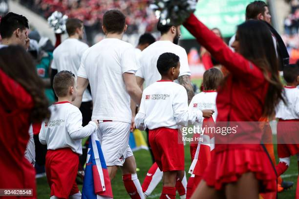 Player escort children wearing a shirt with a message against discrimination for the campaign 'Say No to prejudice' an antidiscrimination campaign of...