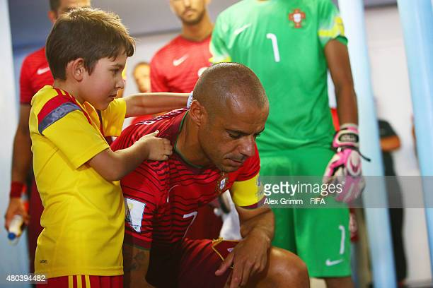 A player escort massages Madjer of Portugal prior to the FIFA Beach Soccer World Cup Portugal 2015 Group A match between Senegal and Portugal at...