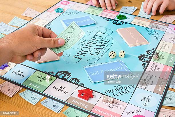 Player exchanging money of property board game