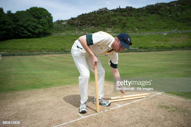 A player fixes the stumps before an annual friendly match between Cravens Cavaliers and Lynton Lynmouth Cricket Club at their ground based inside the...
