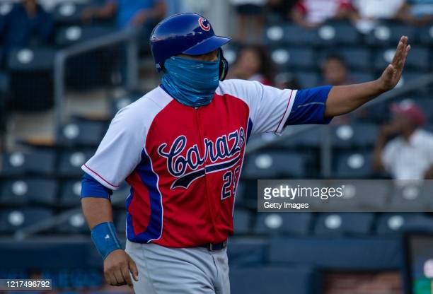 Player fo Cafeteros del Carazo wearing a face mask greets fans a baseball game of Nicaragua's National League between Cafeteros del Carazo and Leones...