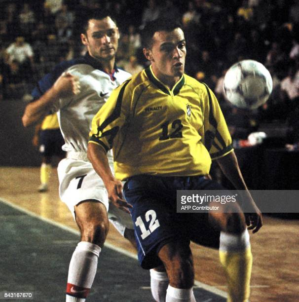 A player for the Brazilian Indoor Soccer Selection Falcao blocks the ball from Mikhail Markin during a game in the IV World Indoor Soccer Match in...