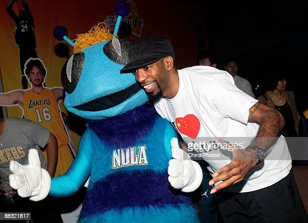 NBA player for the Detroit Pistons Richard Hamilton poses for pictures in a party during which people watch the live broadcast of 2009 NBA Playoffs...