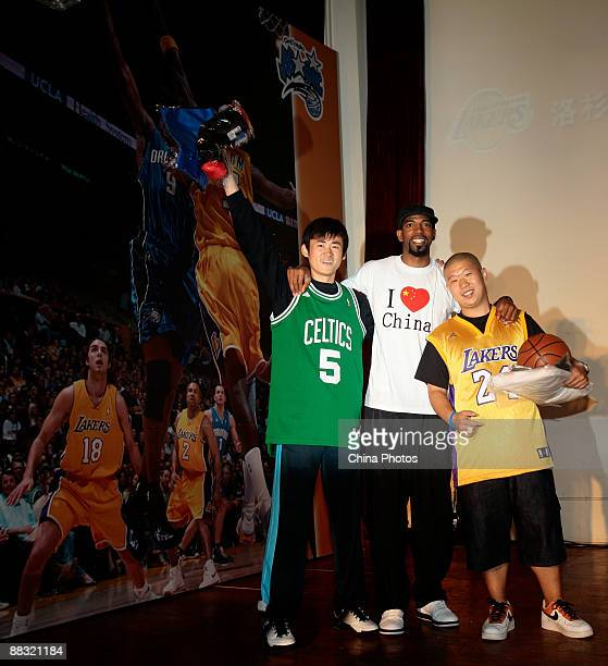 NBA player for the Detroit Pistons Richard Hamilton poses for pictures with fans in a party during which people watch the live broadcast of 2009 NBA...