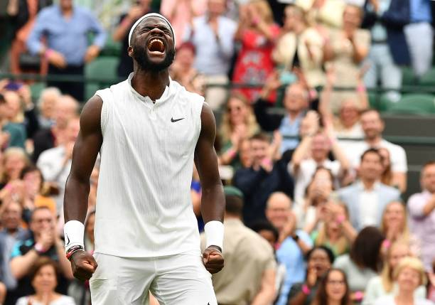 Player Frances Tiafoe celebrates his win over Greece's Stefanos Tsitsipas during their men's singles first round match on the first day of the 2021...