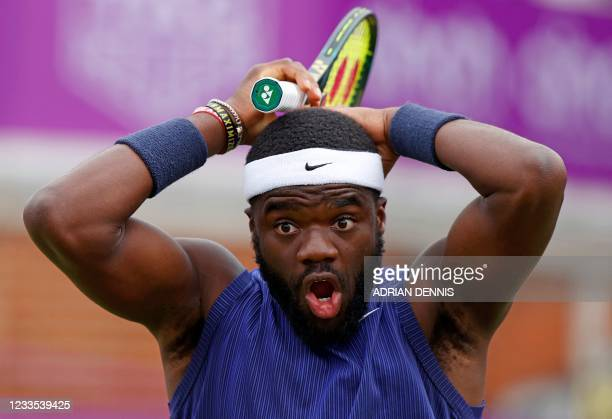 Player Frances Tiafoe reacts after playing a shot into the net against Canada's Denis Shapovalov during their men's singles quarter-final tennis...