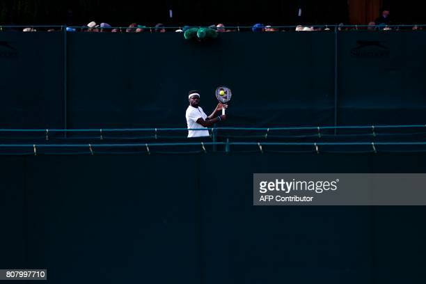 Player Frances Tiafoe returns against Netherlands' Robin Haase during their men's singles first round match on the second day of the 2017 Wimbledon...