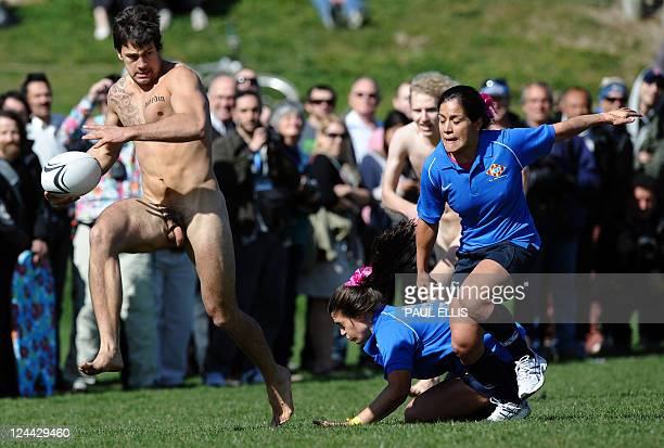 A player from New Zealand Nude Blacks runs with the ball during their match against the Spanish Conquistadores a female team from Barcelona in...