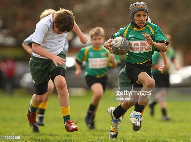 Player from the Eastgardens Stingrays makes a break during the under 10's junior rugby union semi final match between the Eastgardens Stingrays and...