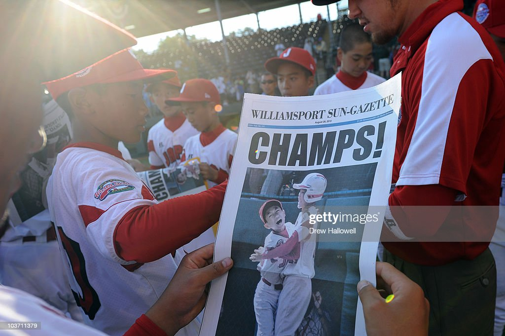 A player from the Japan Little League team looks at the front page of the Williamsport Sun-Gazette after the game against the United States on August 29, 2010 in South Willamsport, Pennsylvania. Japan went on to win the Little League World Series Championship 4-1.