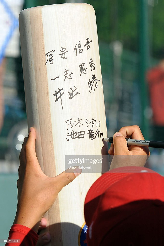 A player from the Japan Little League team signs a giant wood bat after the game against the United States on August 29, 2010 in South Willamsport, Pennsylvania. Japan went on to win the Little League World Series Championship 4-1.