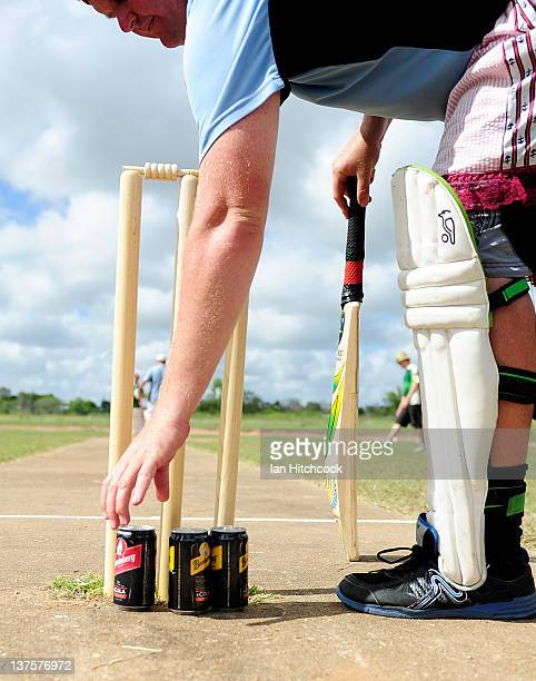 A player from the team 'Wannabies' picks up a drink while batting during the 2012 Goldfield Ashes cricket competition on January 21 2012 in Charters...