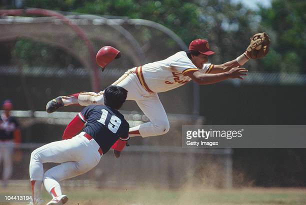A player from USC catches the ball as a player from Taiwan slides in during their Olympic demonstration game on 28th July 1984 at the University of...