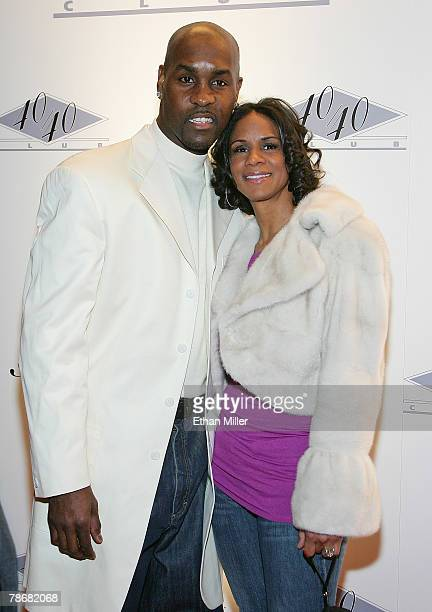 NBA player Gary Payton and his wife Monique Payton arrive at the opening of JayZ's USD 20 million 40/40 Club a 24000squarefoot sports bar and lounge...