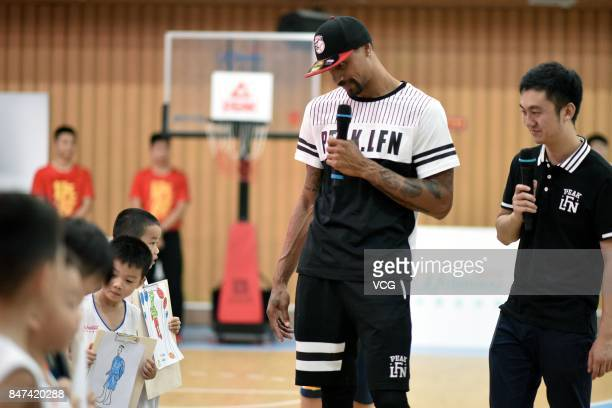 NBA player George Hill of the Sacramento Kings plays basketball with children at a kindergarten on September 15 2017 in Guangzhou China