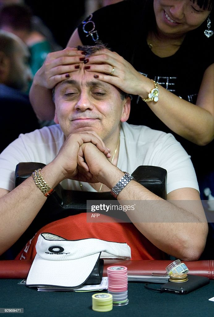 A Player Gets A Massage During The Master Classics Of Poker On The